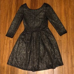 Casual light, short, black sparkly dress.